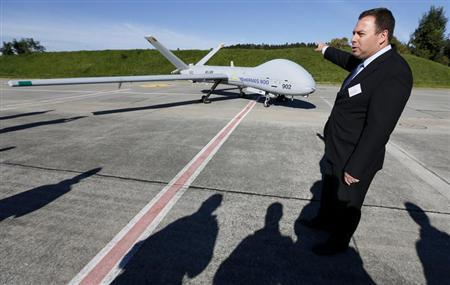 Aharonson General Manager and CEO UAS Division at Elbit Systems Ltd. speaks next to the Elbit Hermes 900 UAV during a media presentation at the airbase in the central Swiss town of Emmen
