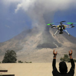 An official of the Center for Research and Technology Volcanoes Development (BPPTK) releases a drone quadcopter to monitor activity from the Mount Sinabung volcano at Sibintun village in Karo district