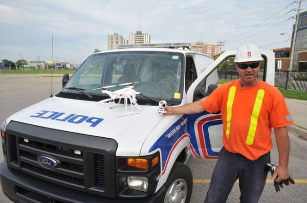 Canada:- A horrified London man watched as his miniature helicopter crashed into a police van Sunday.