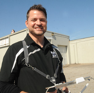 Matt Mishak of DronWerx with a drone off Griswold Rd. in Elyria on Oct. 12.  Steve Manheim