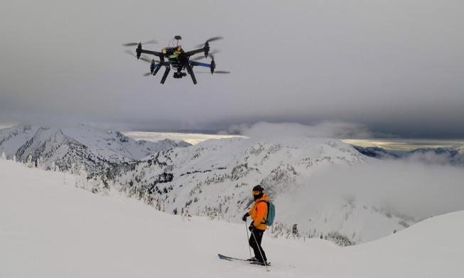 Cape drone autonomously filming with and flying a heli ski guide at CMH Heli Skiing in Revelstoke, Canada.  Photo provided by Cape